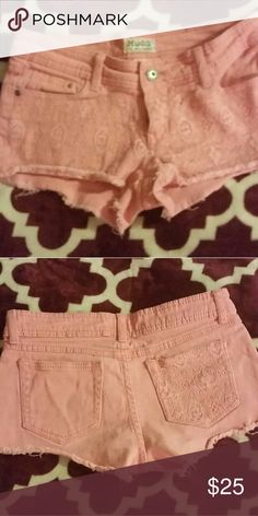 Orange lace jeans These are a light spring color orange very cute for any outfits in the spring or summer worn once like new condition size 3. mudd Shorts