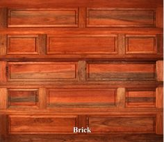 A wooden garage door in Brick style.