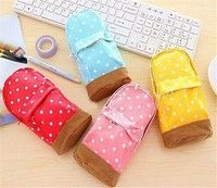 Mini backpack shaped pencil case, with polka dots. Comes in 4 assorted colors for all your pens and pencils!