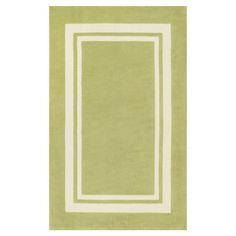 Bring classic style to your dining room or den with this timeless rug, showcasing a refined border motif in a lovely green hue.  Pro...