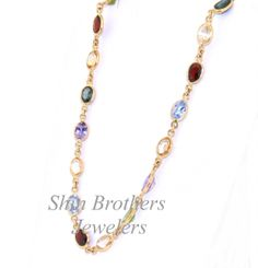 (http://shop.shinjewelers.com/18k-yellow-gold-18-multicolored-gemstone-chain-necklace-32000258/)