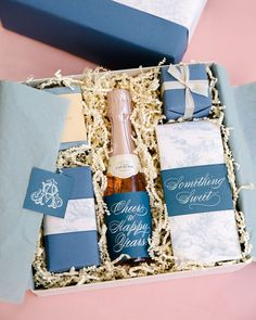Welcome boxes—including chocolate bars and pink bubbly—featured the same toile used in the invitations. #weddingwelcomebags #welcomebags #weddingdetails #weddingideas | Martha Stewart Weddings - A Timeless, Elegant Wedding in Washington, D.C.