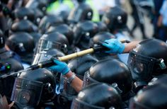 Hong Kong police fire pepper spray at pro-democracy protesters during the first day of the mass civil disobedience campaign Occupy Central, Hong Kong, China, 28 September 2014. EPA/ALEX HOFFORD
