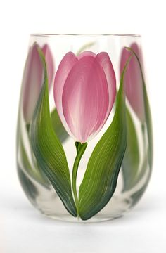 Deep pink and cream tulips with soft green leaves hand-painted encircling a quality 17 oz stemless wine glass. Sealed and heat-cured for added durability. Top-rack dishwasher safe; hand-washing prefer