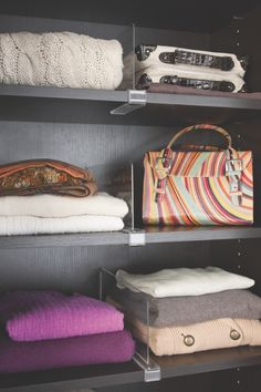 #TIP: Install acrylic vertical dividers in your #closet #shelving to create the perfect sized cubbies to keep purses, sweaters and knicks knacks organized and neatly stored. #Shelfie