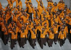 Latvia's flag-bearer Sandis Ozolins leads his country's contingent during the opening ceremony of the 2014 Sochi Winter Olympics, February 7...