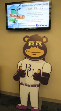 During National Library Week Brutus is taking a tour of our Library. Here he is checking out our Digital Sign so that he will know all the activities going on in the Library this week!
