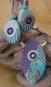 These lovely polymer clay pieces are made by Julie Picarello. Designs, shapes and colours - beautiful. Each one is a mini piece of art. Check out her website.