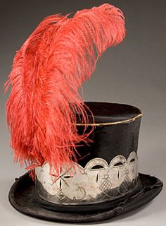 European dresses from the 1800s | black top hat with silver trim and red feather