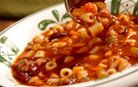 Pasta e Fagoli Soup at the Olive Garden.  White and red beans, ground beef, tomatoes and pasta in a savoury broth.