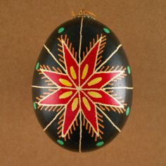 Pysanky from all regions of Ukraine depict an eight-sided star, the most common depiction of the sun. Six- or seven-sided stars can also be seen, but much less commonly. The sun can also appear as a flower or a трилист. The green dots at the tips represent seeds or eggs, symbols of rebirth and patience.