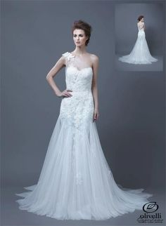 Enzoani's Heli dress is a daring one-shoulder lace dress. Like if you think it is breath taking... pinned with Pinvolve
