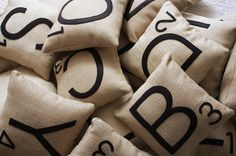 Love these!  Scrabble Letter Pillows - Pay $98 for 4 pillows or make them yourself. (hmm...a little pricey, dontcha think??)