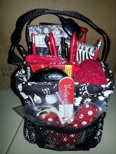 Game night gift basket for my aunt, in a 31 Littles Carry All, done in her favorite colors-red & black.  There are notepads, pens, pencils, snacks, candy, pinochle cards, poker cards, fuzzy socks, an eyeglass case, book light, and for good measure-a 31 nail file & key fob.  Yay 31!!!