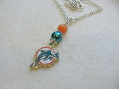 Check out this item in my Etsy shop https://www.etsy.com/listing/178551577/miami-dolphins-football-pendant
