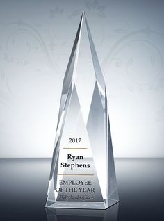 Nothing says congratulations to the Employee of the Year like a crystalline monument. Our Employee of the Year Award Trophy can be personalized to honor any workplace superstar.