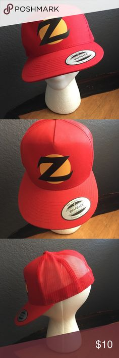 "Red SnapBack trucker hat This funky little number will add a little pizazz to your unique style. Bright red, SnapBack brim, mesh back with adjustable clasp. From the tv sitcom ""Son of Zorn"", but rock that ""Z"" anyway you please! Accessories Hats"