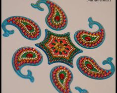 Beautiful one -of-a-kind, light blue kundan rangoli for wedding and festival décor! Use it as a floor art/decorative tile or simply glue it to a canvas and make your own art! Rangoli is a term used in Hindu tradition which is a folk art from India in which patterns are created on the floor in living rooms or courtyards using materials such as colored rice, dry flour, colored sand or flower petals, and it is thought to bring good luck. This rangoli comes with 5 petals and 1 circular sha...