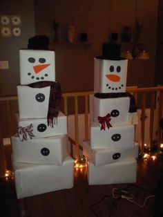 Snowmen made out of bristol board covered cardboard boxes. Used as a backdrop for gradeschool Christmas Concert:)