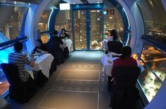 Dining in the sky on the Singapore Flyer - Singapore >>> I've been on the Flyer, but I'd love to try having dinner on it now! :o)