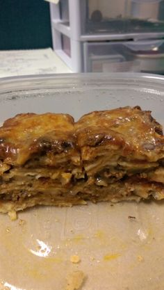 Mexican lasagna (corn tortillas, ground beef, enchilada sauce, cheese, rotel tomatoes, black & pinto beans)