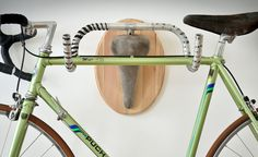 this may have to become hangers in my garage.  -  Recycled handlebars and bike seat. Hang about anything on them - coats, hats, fishing rod, your new bike!