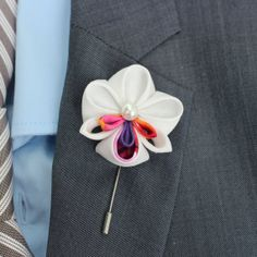 For a fabric flower this is very clean and smooth looking.  Mens wedding natural orchid boutonniere lapel stick by Nevestica, $14.00