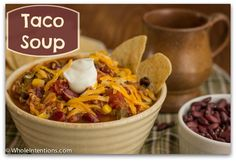 Taco Soup 1/2 c. onions, diced 1/2 c. green or red peppers, diced 3 cloves garlic, minced 1 lb. boneless skinless chicken breasts, cooked & shredded 1 t. chili powder 2 T. (or 1 pkg.) taco seasoning (or homemade mix) 16 oz. salsa 14oz. whole corn kernels, drained 2c. soaked & cooked black beans (or 14 oz. rinsed drained) 2c. soaked & cooked kidney beans (or 14 oz.rinsed and drained) 6 oz. tomato paste 1 qt. chicken stock 28oz. diced tomatoes 8oz. homemade sour cream