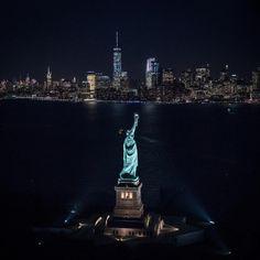 Statue of Liberty at night .
