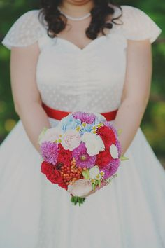 great bouquet colors, photo by L&V Photography http://ruffledblog.com/colorful-italian-wedding #flowers #red #wedding