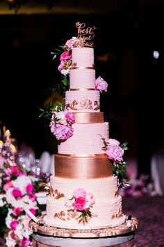 Gorgeous Tall Pink and Gold Wedding Cake with Floral Accent https://www.thecelebrationsociety.com/weddings/flowering-winter-wedding-club-bella-collina-montverde-fl/