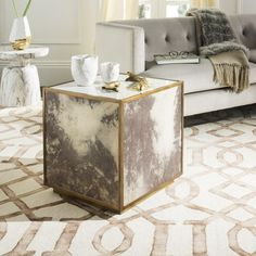 Complement the geometric patterns of urbane home decor with this glam-chic distressed end table. Beautifully constructed of acacia, brass and marble, the abstract design adds a soft accent of pattern to penthouse styled rooms. A bold choice for those looking to stray from the common, neutral end table. #EndTable #Abstract #Chic #Safavieh