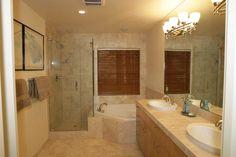 Bathroom with corner tub and adjacent shower