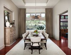 Dining room is semi-enclosed to the media room and open to the Living room. Jonathan Allen Photography