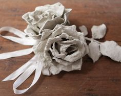 This tutorial is from a few years ago, but it's a goodie! These concrete flowers are inexpensive to make, and look stunning when they're done. They look like carved stone, and are really elegant. You can use them to make a wall hanging, or a sculpture. I used mine as a garden accent, and nestled them into my potted plants. It's a pretty messy project, and is a good one to do outdoors for easier cleanup. Supplies: Cement mix - I picked this particular brand because it sets q...