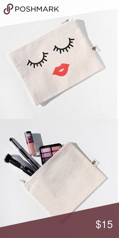 """AOA Canvas Pouch- Lips & Lashes AOA Beauty natural canvas pouch! Super soft and high quality cotton canvas that is perfect to hold all of your essentials!  Pick up several designs, and keep a few in your purse, at your desk, in your car! These pouches are perfect for:  Daily Makeup Pouch Gym Essentials Travel Passport and In Flight pouch Pens and Stationary for school  Sewing Kit Receipt and Money  As your wallet or clutch- put your phone, keys and cards and you're ready!  Size: 6.5"""" x 8""""…"""