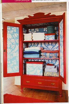 With a little paint and creativity, old furniture pieces can be reborn as one-of-a-kind statement pieces in your home! We love how this armoire has been repurposed into a bold linen closet! Furniture Projects, Furniture Makeover, Diy Furniture, Vintage Furniture, Red Painted Furniture, Craft Projects, Painting Furniture, Furniture Stores, Bedroom Furniture