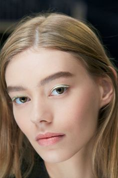 """Peter Philips, Creative and Image Director for Dior Makeup, set a modern trend for delicate expressions of colour next Spring. The """"Pastel Eyes"""" were created using laser-cut patches of satin, in a similar ilk to Fendi's demonstration of leather liner. We love this trend! Stick on material eyeliner as you would falsies with eyelash glue and keep the rest of your makeup natural.  PHOTO:Thibault de Saint Chamas for Parfums Christian Dior -Cosmopolitan.co.uk"""