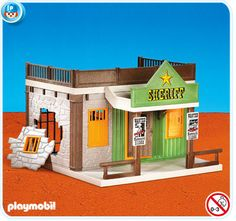 His Daddy had to get him the Sheriff Playmobil building;)