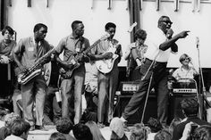 Howlin' Wolf (right) and his band, July 1966, Newport Folk Festival. Photo credit: © David Gahr Estate, courtesy Morrison Hotel Gallery.