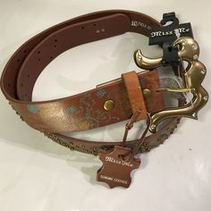 """Miss Me Laced Leather Belt Miss Me Brown Embroidered Leather Belt. Scattered studs and rhinestones. Muted cream and blue painted detail. Size small. From end to end (excluding buckle) measurements:  36"""", 1  1/2"""" Wide. Accepting offers. Miss Me Accessories Belts"""