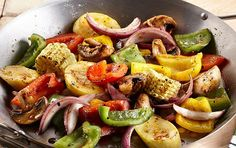 Roasted Garlic Grilled Vegetables - 8 cups assorted cut up vegetables - zucchini - squash - mushrooms - onions - bell peppers - etc. - oil - McCormick Grill Mates Roasted Garlic and Herb Seasoning - or you own seasoning