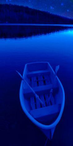 blue boat under a cobalt blue night sky