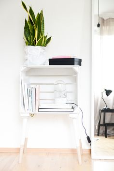 DIY side table or night stand made with a crate