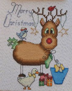 Rebecca The Reindeer Merry Christmas is the title of this cross stitch pattern from MarNic Designs.