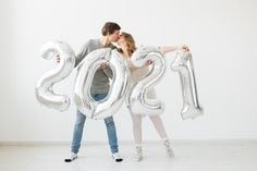 22 Cute Engagement Announcement Ideas You'll Want to Copy - Trust us—you won't want to spill the beans until you've seen these cute and creative engagement announcement ideas. silver balloons number 2021 kiss {Tatiana Chekryzhova/Shutterstock} Creative Engagement Announcement, Engagement Photos, Number Balloons, Focus Photography, Cute Signs, Party Props, Real Couples, Best Part Of Me, Watercolor Flowers