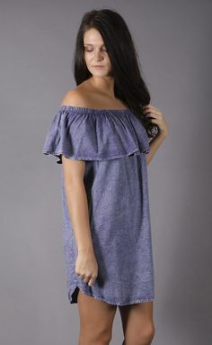 It's all in the layers. This dress features an off-the-shoulder design, ruffle at top, and slightly washed purplefabric. We love it paired with a choker and bo