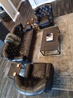 Living room: Floors - CIR Maniffature Ceramiche (Saint Barth collection, color - Barbanera), Sofa & Recliners - Restoration Hardware (Churchill Collection, color - Vintage Ebony leather), Coffee & End Tables - Restoration Hardware (Tesoro Collection), Throw - Restoration Hardware (Exotic Faux Fur Siberian Grey Fox), Rug - Home Decorators (Cordelia, color - grey)