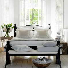White summer bedroom with wooden floor and shutters | Bedroom decorating ideas | PHOTO GALLERY | Homes & Gardens | Housetohome.co.uk