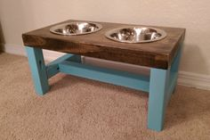 *** Farmhouse Style Dog Bowl Feeder ***  This farmhouse style dog bowl feeder is a doggie version of a classic farmhouse table! This feeder has painted turquoise legs. This item is ideal for a medium sized dog (ex: britney spaniel, bulldog, shetland sheepdog). * * * Product Details * * *  - Dimensions: L: 17 in. W: 9 1/4 in. H: 8 1/2 in. - Comes with 2 27 oz. stainless steel dog bowls - Stained wood sealed with a protective coating - Painted legs in beautiful turquoise  *** If you h...